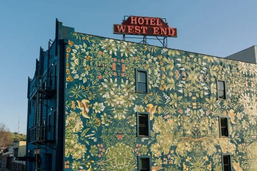 Culver City - exterior floral mural and HOTEL WEST END historic neon sign on roof