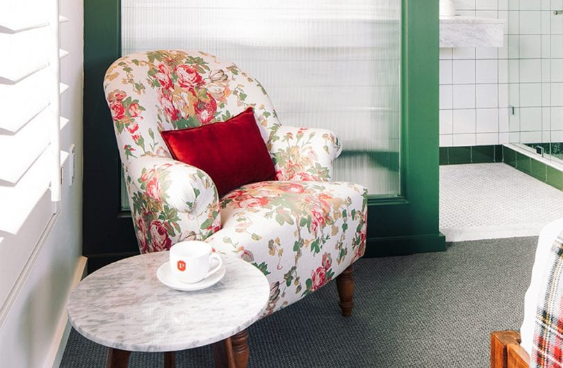 Culver City - room detail - floral chair and side table with coffee cup