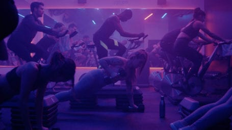 Indigo fitness people working out in moody purple lighting
