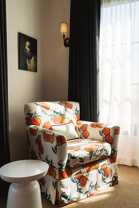 Phsm comfy chair with large oranges in patern