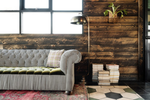 entrance couch with books plants
