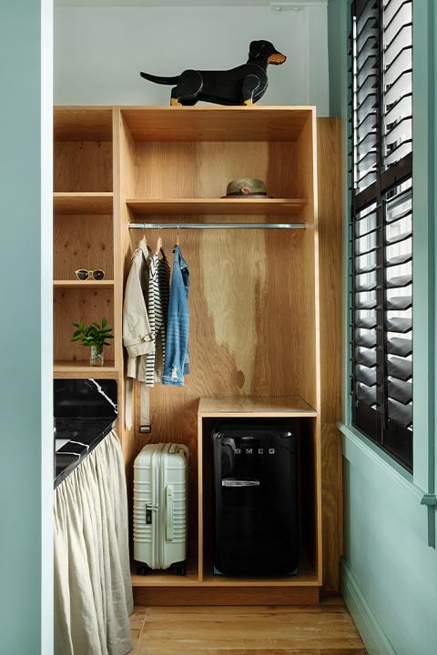 grand stark modelroom main closet area and smeg mini fridge