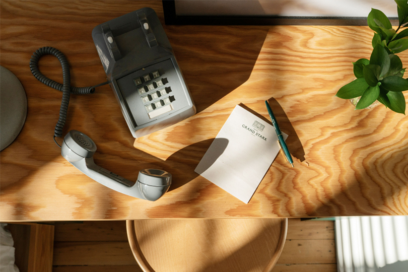 phone and notepad on desk in room