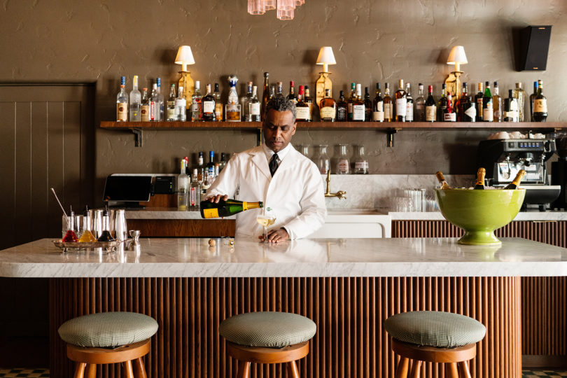 bartender pouring drink at bar