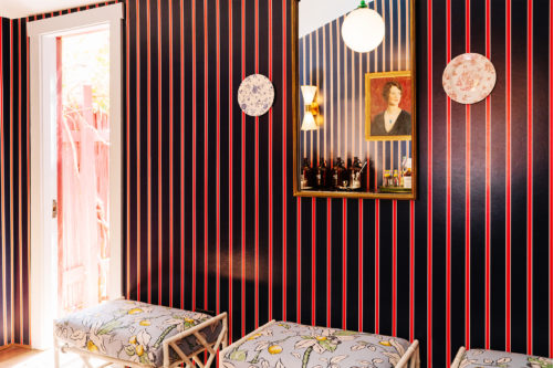 honor bar seating and striped wall paper