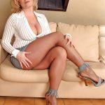 Blonde Milf Showing Cleavage Wearing Suntan Pantyhose