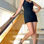 Blonde Teen, Black Dress, Long Legs In Pantyhose And Heels