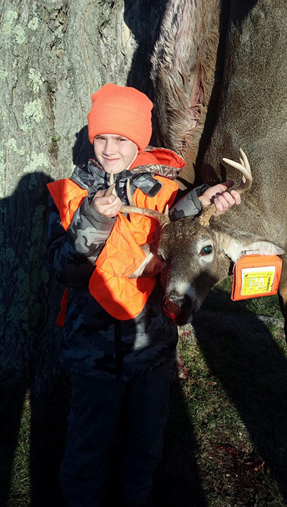 Dylan M. Submitted by his mother, Moe M. Dylan went out hunting for the first time this year. The first day of rifle, my lucky little hunter bagged this big guy!