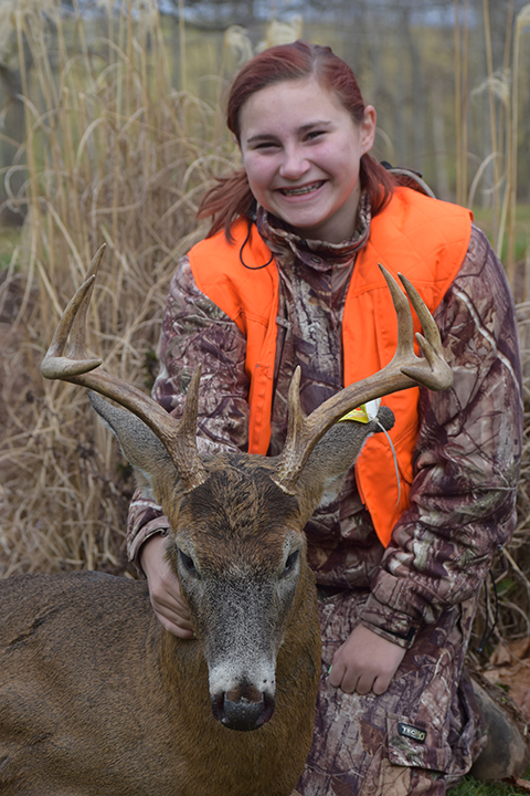 """Samantha S. 14 year old Samantha downed this buck at 145yds with her Ruger 7mm 08 in Sullivan county. The 9pt buck had an 18"""" outside spread."""