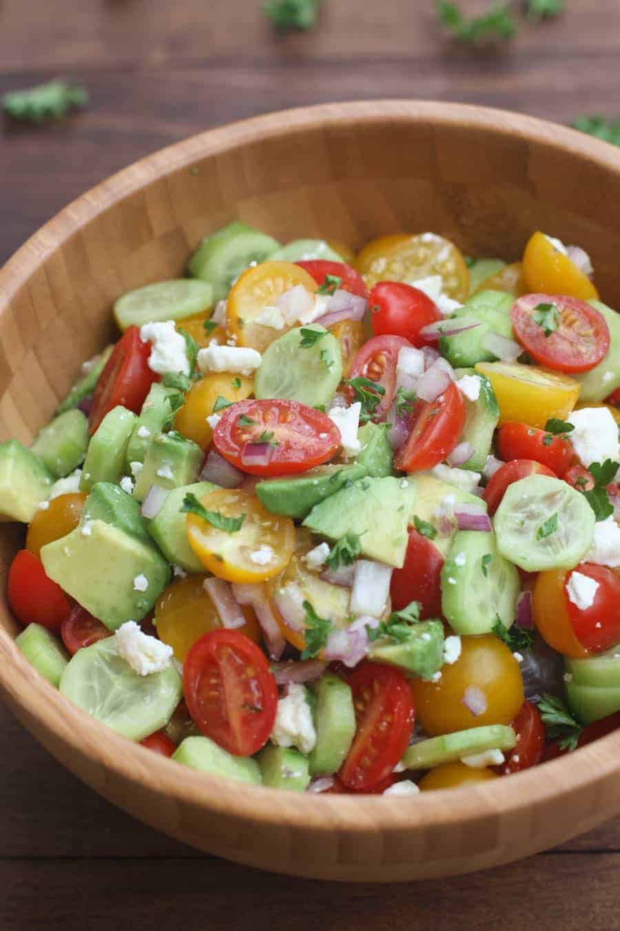 tastes better from scratch tomato cucumber avocado salad - 12 Refreshing Dinner Dishes Perfect for Hot Weather