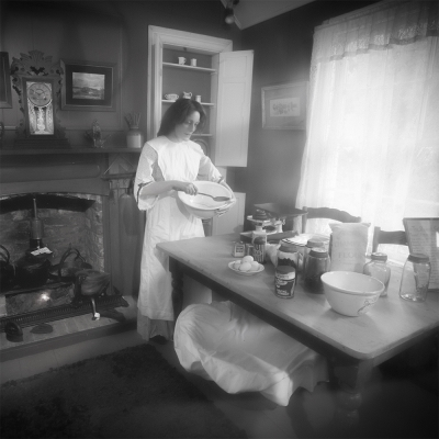 Woman_batting_a_mix_in_a_19th_century_kitchen,_Auckland_-_0892.jpg
