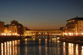 The beautiful Ponte Vecchio at sunset in Florence.