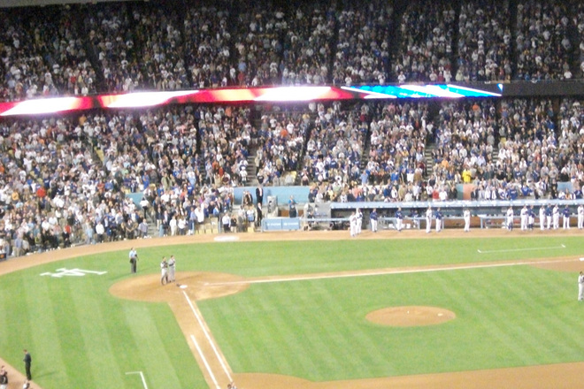 Baseball fans enjoying a game at Dodger Stadium.