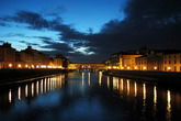 A shot of the Ponte Vecchio in Florence with clouds looming above.