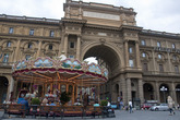 Piazza arches and carousel in the center of Florence.