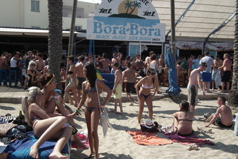 Girls in bikinis at Bora Bora beach bar in Ibiza.