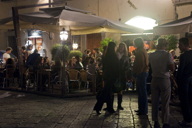 Friends mingling outside of Cabiria in Florence.