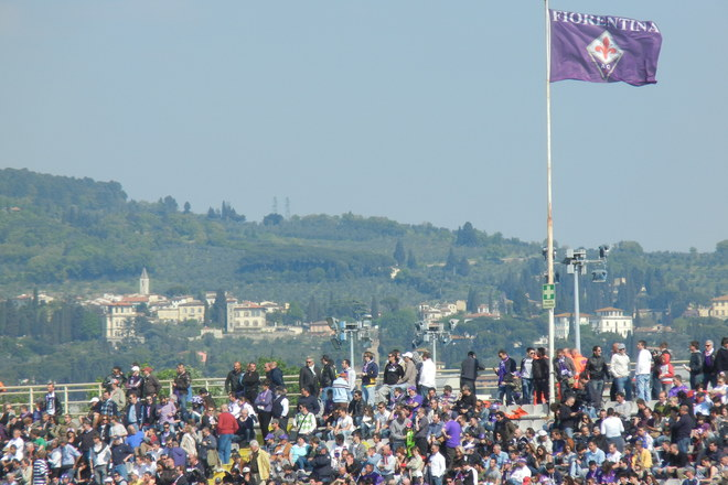 Fans at a Fiorentina soccer game.
