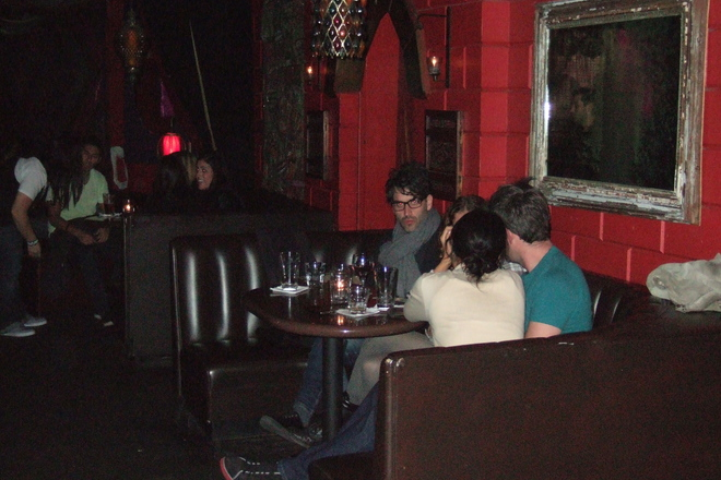 Two couples hanging in a booth. Look at that scarf! At 4100 Bar in Los Angeles.