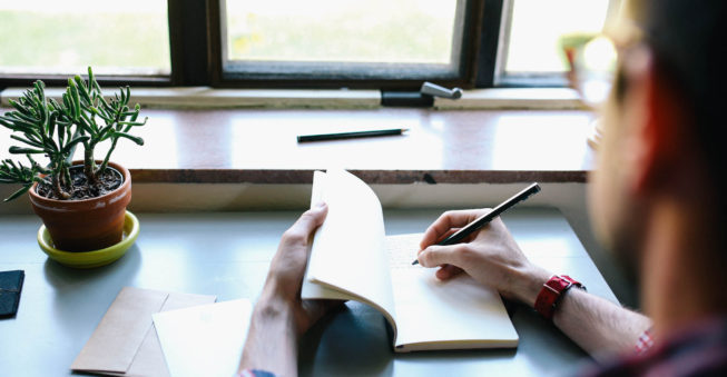 Writing at desk; what is a business plan?