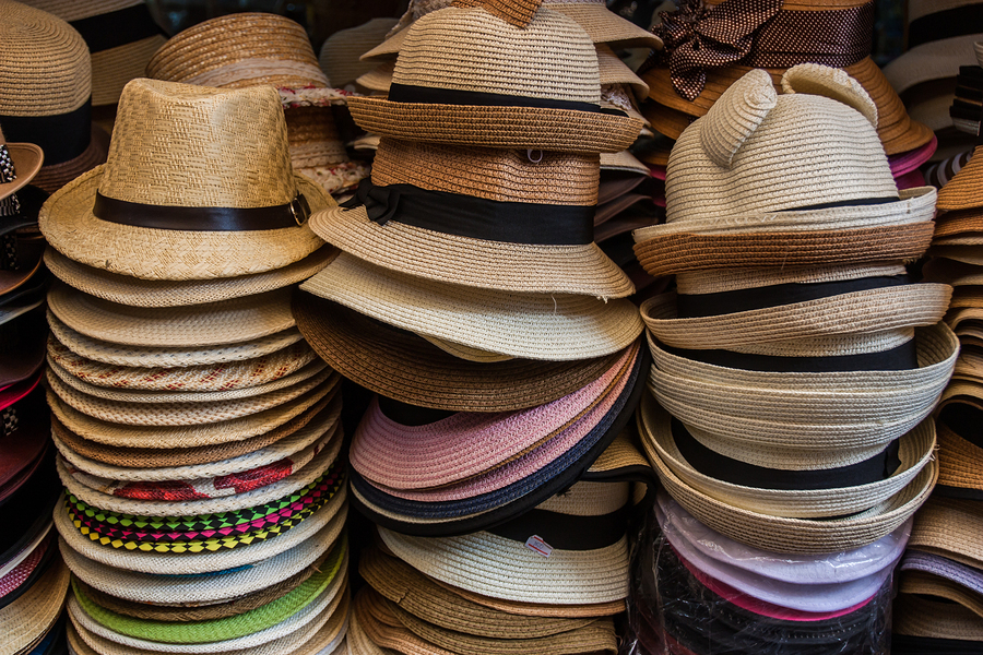 stacks of hats; outsourcing work concept