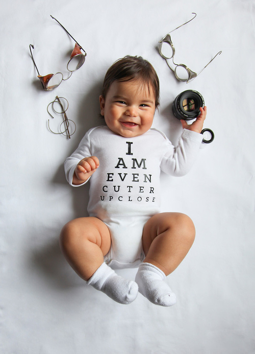 Adorable baby in pun-filled onesies