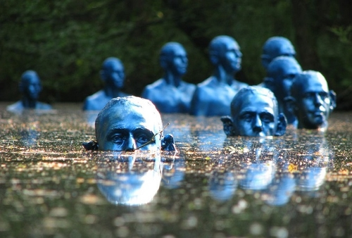 Eerie blue men visible in the rising tides of climate change