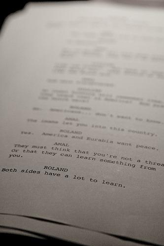 How do screenplays divide dialogue by gender?