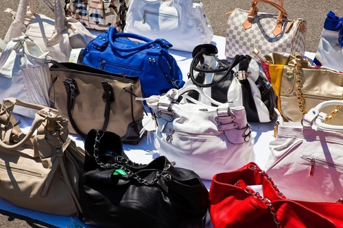 Social networks and counterfeited luxury goods