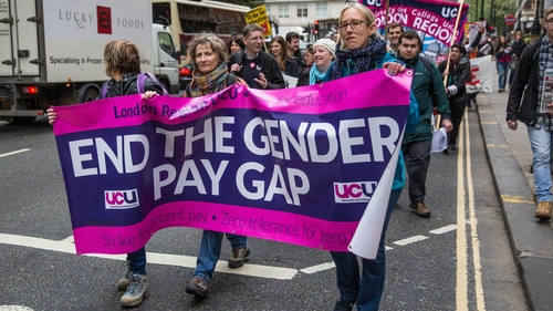 Gender pay gap halved for UK women in their 20s