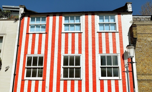 The story of the controversial candy-stripe house