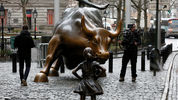 Young Girl Facing Wall Street's Famous Charging Bull
