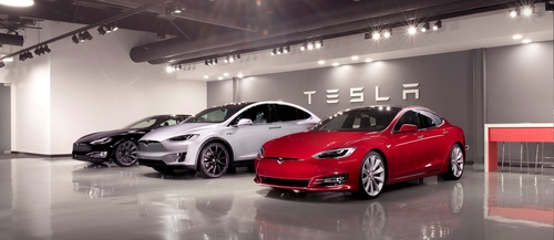 Tesla already bundles insurance with cars