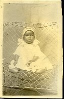 Image of Collection of historic photographs - Baby in white on wire chair