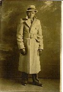 Image of Collection of historic photographs - Young gentleman in hat and overcoat