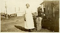 Image of Collection of historic photographs - Middle-aged woman (Mrs. Devereaux) leaning against a tree stump