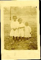Image of Collection of historic photographs - Three children all dressed in white.
