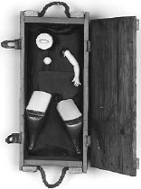 "Image of Hoe, Spirit versus Technology Series - assemblage in ammunition box of female figure constructed with a ""hoe"" used to create her pelvis."