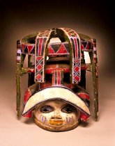 Image of elaborate double tier headdress, polychrome pigments.