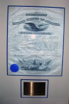 """Image of United States Army Commission of Allen Allensworth to Chaplain with rank of Major - U.S. Army commission signed by the President of the United States and Secretary of War. Framed with a brass plaque that reads, """"Theodore Roosevelt commissions Allen Allensworth, one of the first African American Chaplains in the United States Army, as a Major. This document is also countersigned by future President and Supreme Court Chief Justice William Howard Taft. Document signed December 30, 1904."""""""