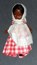 Image of Mammy: Family Series #89 - Young Black girl wears red/white gingham dress with white kerchief and apron, and black boots. Jointed arms and legs.