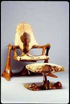 Image of Woman - top-suspended with footstool, made in Japanese oak on wooden bearings of lignin vitae which are capped in ivory; coverings are gold-brown matching African goat skins.