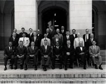 Image of Mervyn Dymally shown photographed in the California State Assembly. He is shown seated at the bottom row, fourth from the right.