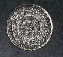 Image of Round Aztec calendar silver  pin