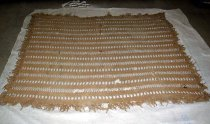 Image of Beige crocheted quilt
