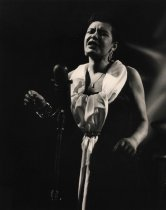 """Image of Billie Holiday - Jazz singer Billie Holiday (1915 - 1959) at microphone performing for """"Stars of Jazz."""""""