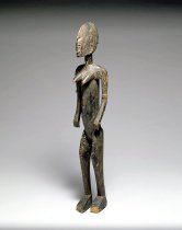 Image of Female figure, elegant angularity of body and legs with extensive scarification, protruding breasts. Left foot and head need repair, good age.