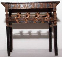 Image of pyro-engraved wooden table made for export; carved figures and African mammals