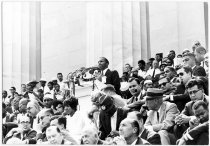 Image of SNCC's John Lewis was there, after he changed his speech. - Image of John Lewis at a podium from the historic March on Washington , leader of the Student Nonviolent Coordinating Committee (SNCC).