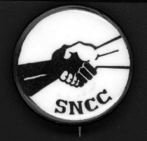 """Image of Black and White hands grasped in a handshake with """"SNCC"""" lettering beneath."""
